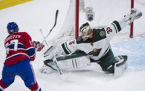 Minnesota Wild's goaltender Darcy Kuemper makes a save against Montreal Canadiens' Max Pacioretty during the third period of an NHL hockey game, Tuesday, Nov. 19, 2013 in Montreal. (AP Photo/The Canadian Press, Graham Hughes)
