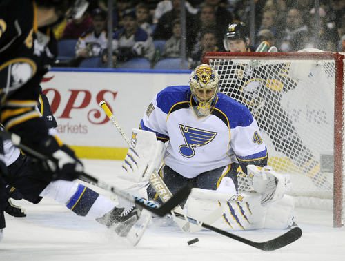 St. Louis Blues goaltender Jaroslav Halak (41), of Slovakia, makes a save against the Buffalo Sabres during the first period of an NHL hockey game in Buffalo, N.Y., Tuesday, Nov. 19, 2013. (AP Photo/Gary Wiepert)