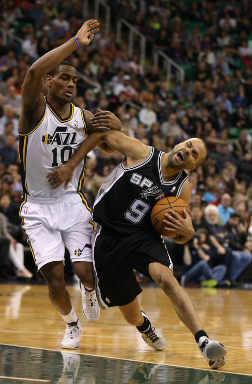 San Antonio Spurs' Tony Parker, right, is fouled by Utah Jazz's Alec Burke during the second half of an NBA basketball game in Salt Lake City, Friday, Nov. 15, 2013. The spurs beat the Jazz 91-82. (AP photo/George Frey)