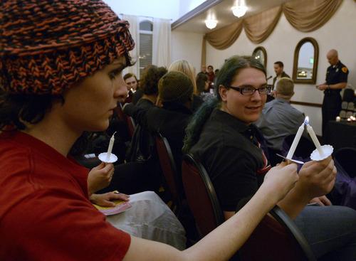 Rick Egan    The Salt Lake Tribune   Aisling Pompei (left) and Lea Fairbanks (right) light candles during the International Transgender Day of Remembrance program and candlelight vigil, Wednesday, November 20, 2013.