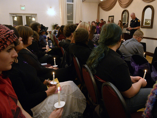 Rick Egan  | The Salt Lake Tribune   Salt Lake City Police Chief Chris Burbank joins Transgender Education Advocates in conjunction with Equality Utah as he reads the names of those who lost their lives by acts of violence, during a candlelight vigil, Wednesday, November 20, 2013.