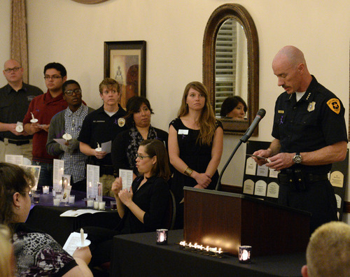 Rick Egan    The Salt Lake Tribune   Salt Lake City Police Chief Chris Burbank joins Transgender Education Advocates in conjunction with Equality Utah as he reads the names of those who lost their lives by acts of violence, during a candlelight vigil, Wednesday, November 20, 2013.