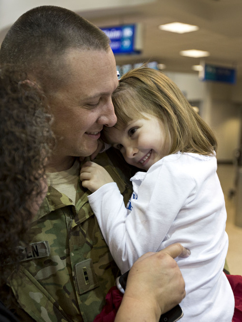 Lennie Mahler  |  The Salt Lake Tribune Kaj Petersen embraces his daughter, Gabrielle, at the Salt Lake City International Airport, Thursday, Nov. 21, 2013. Two pilots and four crew members of the Utah Army National Guard returned to Utah from a nine-month deployment to Afghanistan.