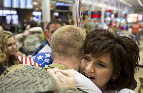 Lennie Mahler  |  The Salt Lake Tribune Lorrie Gillies embraces her son, Shea Gillies, at the Salt Lake City International Airport, Thursday, Nov. 21, 2013. Two pilots and four crew members of the Utah Army National Guard returned to Utah from a nine-month deployment to Afghanistan.