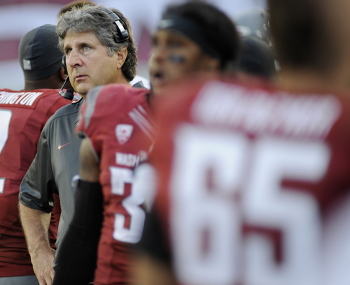 Washington State coach Mike Leach watches from the sidelines as his team takes on Southern Utah during the second half of an NCAA college football game, Saturday, Sept. 14, 2013, in Pullman, Wash. Washington State won 48-10. AP Photo/Rajah Bose)