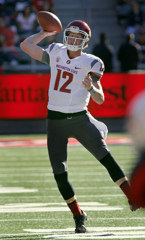 Washington State's quarterback Connor Halliday throws against Arizona in the second half of an NCAA college football game on Saturday, Nov. 16, 2013, in Tucson, Ariz. Washington State won 24 - 17. (AP Photo/John MIller)