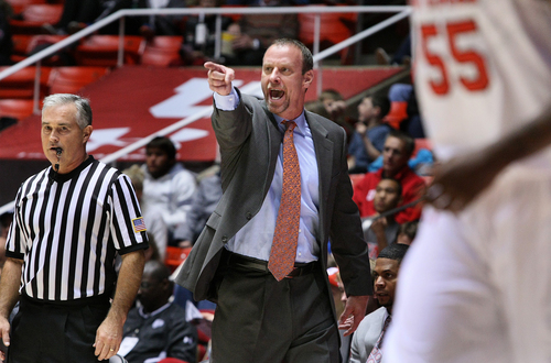 Utah Utes head coach Larry Krystkowiak yells instructions to his team during second half play. Utah defeated UC Davis 94-60, Friday, November 15, 2013 in Salt Lake City, Utah.  (AP Photo/The Salt Lake Tribune, Scott Sommerdorf)