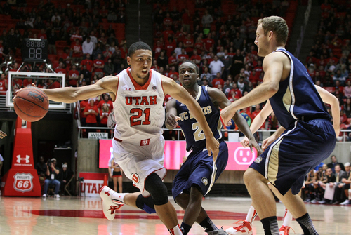 Utah Utes forward Jordan Loveridge (21) drives through the key during second half play. Utah defeated UC Davis 94-60, Friday, November 15, 2013 in Salt Lake City, Utah.  (AP Photo/The Salt Lake Tribune, Scott Sommerdorf)