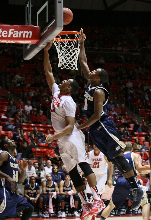 Utah's Princeton Onwas (3) drives for a layup past the defense of UC Davis guard Lemar Brynton during the first half of an NCAA college basketball game Friday, Nov. 15, 2013, in Salt Lake City. (AP Photo/The Salt Lake Tribune, Scott Sommerdorf) DESERET NEWS OUT  LOCAL TV OUT  MAGS OUT
