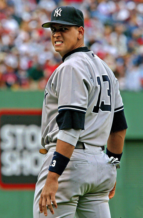 FILE - In this July 2004 file photo, New York Yankees third baseman Alex Rodriguez reacts to heckling from Boston Red Sox fans during a game at Fenway Park in Boston. Rodriguez walked out of his grievance hearing Wednesday, Nov. 20, 2013, in New York,  after arbitrator Fredric Horowitz refused to order baseball Commissioner Bud Selig to testify. A person familiar with the session said that after Horowitz made his ruling, the New York Yankees third baseman slammed a table, uttered a profanity at MLB Chief Operating Officer Rob Manfred and left. The person spoke on condition of anonymity because what takes place at the hearing is supposed to be confidential. (AP Photo/Winslow Townson)