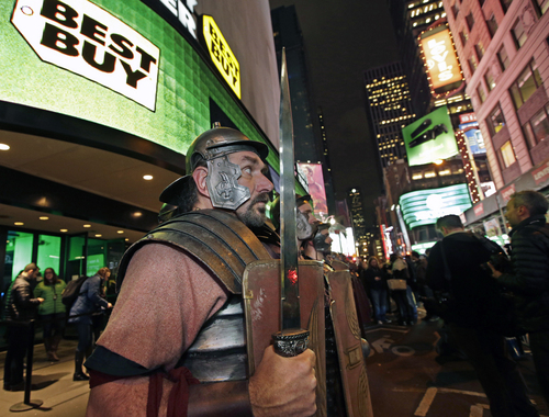 Xbox characters dressed as Roman soldiers stand at attention outside the Best Buy Theater in Times Square after arriving in advance of the midnight launch of  Microsoft's Xbox One video game console, Thursday, Nov. 21, 2013, in New York. (AP Photo/Kathy Willens)