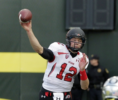 Utah quarterback Adam Schulz passes during the first half of an NCAA college football game against Oregon in Eugene, Ore., Saturday, Nov. 16, 2013. (AP Photo/Don Ryan)