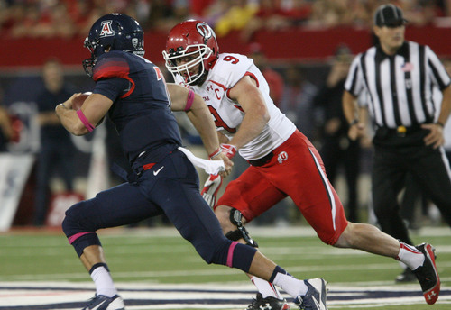 Steve Griffin  |  The Salt Lake Tribune  Utah Utes defensive end Trevor Reilly (9) lines up to tackle Arizona Wildcats quarterback B.J. Denker (7) during first half action in the University of Utah versus University of Arizona football game at Arizona Stadium in Tucson, Ariz., Saturday, October 19, 2013.