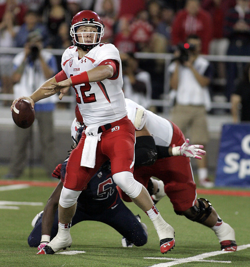 Utah's quarterback Adam Schulz (12) is almost sacked by Arizona as he looks to pass in the second half of an NCAA collge football game, Saturday, Oct. 19, 2013 in Tucson, Ariz. Arizona won 35 to 24. (AP Photo/John Miller)
