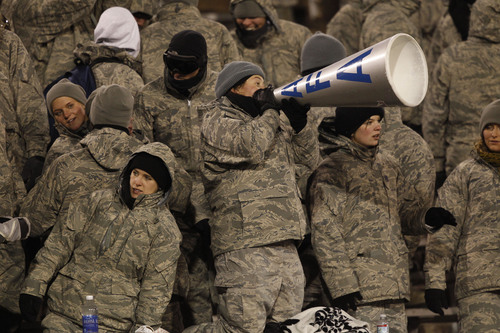 Bundled against single-digit temperatures, cadets Air Fore cadets cheer as Air Force hosts UNLV in the third quarter of an NCAA football game at Air Force Academy, Colo., on Thursday, Nov. 21, 2013. (AP Photo/David Zalubowski)