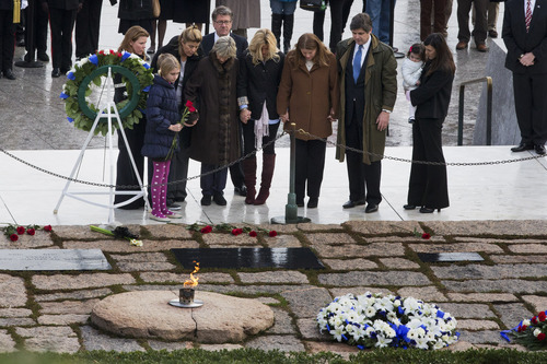 Jacquelyn Martin  |  The Associated Press Members of the Kennedy family, including former US Ambassador to Ireland Jean Kennedy Smith, fourth from left, hold hands as they pay their respects at the gravesite of President John F. Kennedy on Friday at Arlington National Cemetery in Arlington, Va., on the 50th anniversary of Kennedy's death.