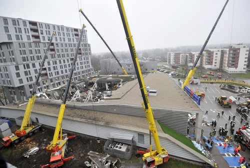 A  view of the collapsed Maxima supermarket in Riga, Latvia, Friday, Nov. 22, 2013. At least 32 people died, including three firefighters, after an enormous section of roof collapsed at a Latvian supermarket in the country's capital, emergency medical officials said Friday. The reason for the collapse during shopping rush-hour Thursday was still not known but rescue and police officials said that possible theories include building's design flaws and poor construction work. (AP Photo/ Roman Koksarov)