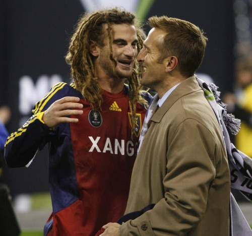 Trent Nelson  |  The Salt Lake Tribune RSL coach Jason Kreis hugs Real Salt Lake midfielder Kyle Beckerman (5) after the win. Real Salt Lake vs. LA Galaxy, MLS Cup Sunday, November 22 2009 at Qwest Field in Seattle.
