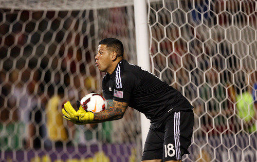Steve Griffin | The Salt Lake Tribune  Real Salt Lake's Nick Rimando scoops up a shot during second half action of the RSL vs. Portland U.S. Open Cup semifinals soccer match at Rio Tinto Stadium in Sandy, Utah Wednesday August 7, 2013.