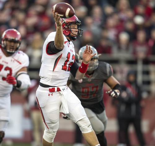 Utah quarterback Adam Schulz (12) throws a pass against Washington State during the second half of an NCAA college football game on Saturday, Nov. 23, 2013, in Pullman, Wash. Washington State won 49-37. (AP Photo/Dean Hare)