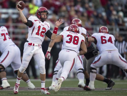Utah quarterback Adam Schulz (12) throws a screen pass against Washington State during the first half of an NCAA college football game on Saturday, Nov. 23, 2013, in Pullman, Wash. (AP Photo/Dean Hare)