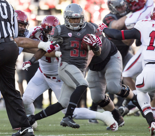 Washington State running back Marcus Mason (35) slips a Utah tackle-attempt during the first half of an NCAA college football game on Saturday, Nov. 23, 2013, in Pullman, Wash. (AP Photo/Dean Hare)