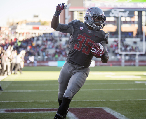 Washington State running back Marcus Mason (35) celebrates after catching a pass for a touchdown against Utah during the first half of an NCAA college football game on Saturday, Nov. 23, 2013, at Martin Stadium in Pullman, Wash. Washington State won 49-37. (AP Photo/Dean Hare)