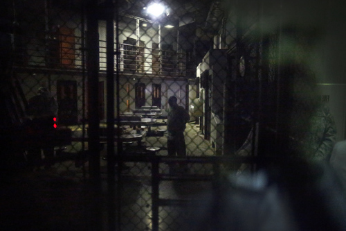 In this photo reviewed by the U.S. military, detainees behind a mirrored one-way window get ready for pre-dawn Islamic prayers in Camp VI detention facility at Guantanamo Bay Naval Base, Cuba, Wednesday, Nov. 20, 2013. Today, 164 al-Qaida and Taliban militants who were captured after the Sept. 11 attacks are held at Guantanamo, down from a peak of about 660 a decade ago. (AP Photo/Charles Dharapak)