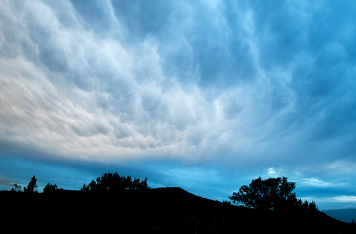 This Nov. 21, 2013 photo shows a winter storm moving into Flagstaff, Ariz. A strong storm system pumped Pacific moisture into Arizona on Thursday into Friday, giving the state a blast of wet weather, with more expected over the weekend. (AP Photo/The Arizona Daily Sun, Taylor Mahoney)