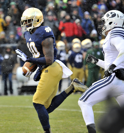 Notre Dame wide receiver Devaris Daniels heads towards the end zone after making a catch in the first half of an NCAA college football game Saturday, Nov. 23, 2013, in South Bend, Ind.  (AP Photo/Joe Raymond)