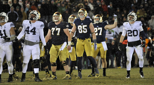 Brigham Young and Notre Dame players watch Kyle Brindza's 51 yard field goal in the second half of an NCAA college football game Saturday, Nov. 23, 2013, in South Bend, Ind. Brigham Young Remington Peck, (44), and Craig Bills, (20) , and Notre Dame Matt Hegarty, (77), Troy Niklas, (85), Kyle Brindza, (27). Notre Dame won 23-13. (AP Photo/Joe Raymond)