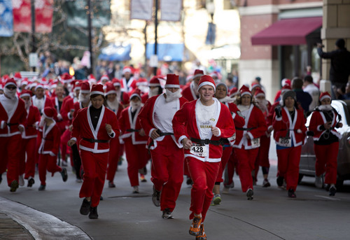 Lennie Mahler  |  The Salt Lake Tribune Haden Penrod leads a pack of about 600 runners dressed as Santa Claus in the Gateway Mall for the annual 5K Santa Run on Saturday, Nov. 23, 2013. Penrod, who runs cross country at Springville High, finished the race first with a time of 17:14.