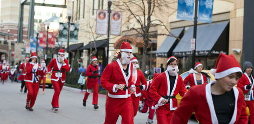 Lennie Mahler  |  The Salt Lake Tribune A group of about 600 runners dressed as Santa Claus race through the Gateway Mall for the annual 5K Santa Run on Saturday, Nov. 23, 2013.