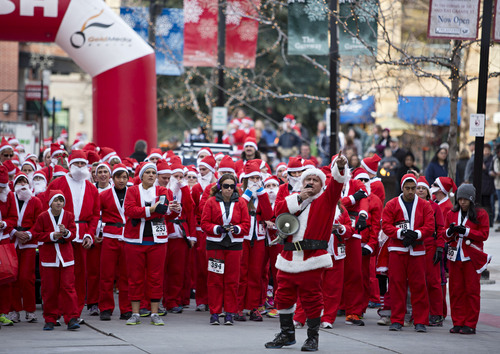 Lennie Mahler  |  The Salt Lake Tribune A group of about 600 runners dressed as Santa Claus gather in the Gateway Mall for the annual 5K Santa Run on Saturday, Nov. 23, 2013.