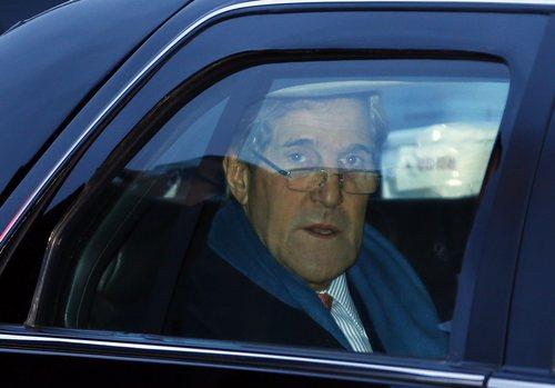 U.S. Secretary of State John Kerry arrives at Geneva International airport in Geneva, Switzerland, Saturday, Nov.  23, 2013 for closed-door talks on Iran's nuclear program. . (AP Photo/Denis Balibouse,Pool)
