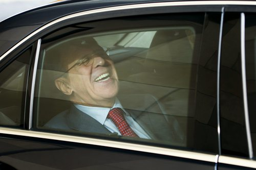 Russian Foreign Minister Sergey Lavrov  laughs  in his car as he leaves the International Hotel  where talks on  Iran's nuclear program take place, in Geneva, Switzerland, Saturday, Nov. 23, 2013.   U.S. Secretary of State John Kerry and five foreign ministers joined Iran nuclear talks Saturday, cautioning there were no guarantees their participation would be enough to seal a deal to curb Tehran's atomic program. The goal is a six-month agreement to freeze Iran's nuclear program while offering Iran incentives through limited sanctions relief. If the interim deal holds, the parties would negotiate final stage deals to ensure Iran does not build nuclear weapons. (AP Photo/Keystone,Jean-Christophe Bott)