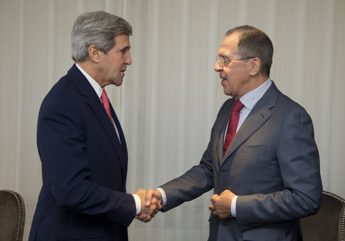 U.S. Secretary of State John Kerry, left and Russia's Foreign Minister Sergei Lavrov shake hands, during a photo opportunity, prior to their meeting, in Geneva, Switzerland,  Saturday, Nov. 23, 2013. U.S. Secretary of State John Kerry and foreign ministers of other major powers joined Iran nuclear talks on Saturday, throwing their weight behind a diplomatic push to complete a deal after envoys reported progress on key issues blocking an interim agreement to curb the Iranian program in return for limited sanctions relief. (AP Photo/Carolyn Kaster, Pool)