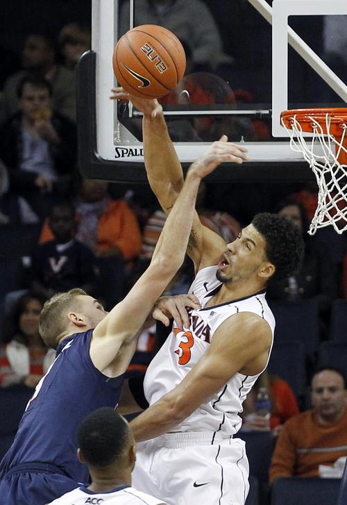 Virginia guard London Perrantes (23) blocks the shot of Liberty center Joel Vander Pol (21) during the first half of an NCAA college basketball game Saturday, Nov. 23, 2013, in Charlottesville, Va. (AP Photo/Andrew Shurtleff)