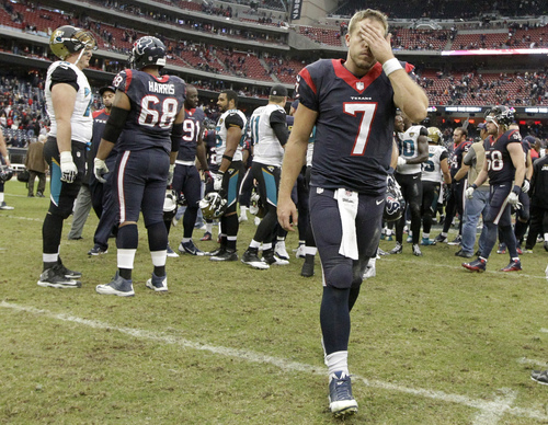 Houston Texans quarterback Case Keenum (7) leaves the field after an NFL football game against the Jacksonville Jaguars Sunday, Nov. 24, 2013, in Houston. The Jaguars won 13-6. (AP Photo/Patric Schneider)