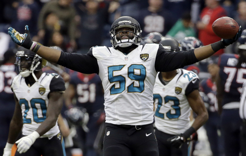 Jacksonville Jaguars defensive end Ryan Davis (59) celebrates his interception against the Houston Texans during the fourth quarter of an NFL football game Sunday, Nov. 24, 2013, in Houston. The Jaguars won 13-6. (AP Photo/David J. Phillip)