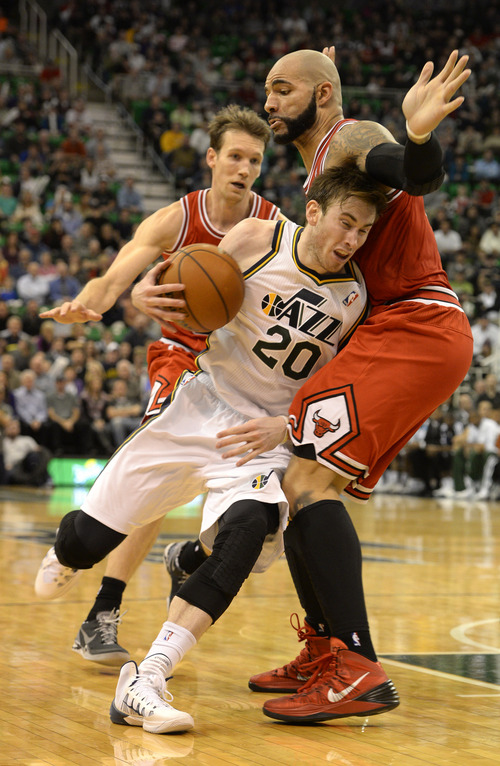 Rick Egan    The Salt Lake Tribune   Utah Jazz shooting guard Gordon Hayward (20) goes one-on-one with Chicago Bulls power forward Carlos Boozer (5), in NBA action, as theJazz faced the Chicago Bulls, at the EnergySolutions Arena, Monday, November 25, 2013.