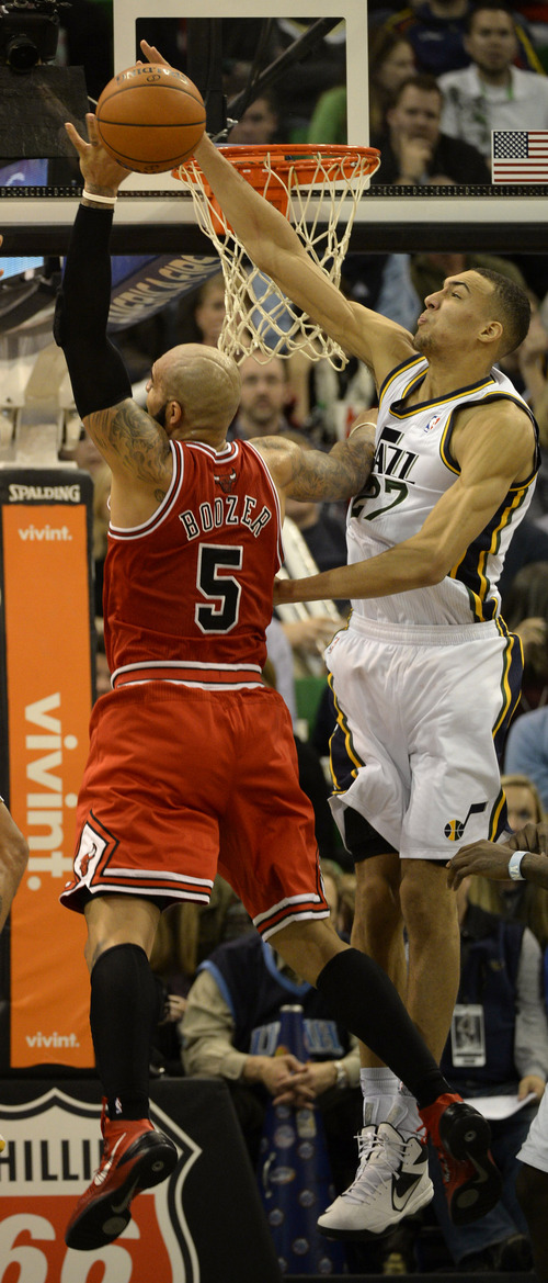 Rick Egan    The Salt Lake Tribune   Utah Jazz center Rudy Gobert (27) blocks a shot by Chicago Bulls power forward Carlos Boozer (5), in NBA action, as the Jazz faced the Chicago Bulls, at the EnergySolutions Arena, Monday, November 25, 2013.