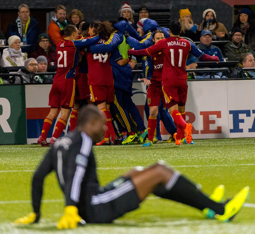 Trent Nelson     The Salt Lake Tribune Players celebrate a goal by Real Salt Lake's Robbie Findley (10) as Portland's Donovan Ricketts (1) is on the ground, as Real Salt Lake faces the Portland Timbers, MLS soccer Sunday November 24, 2013, in Portland.