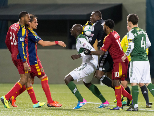 Trent Nelson     The Salt Lake Tribune Players push and shove each other after Real Salt Lake's Chris Schuler (28) collided with Portland's Donovan Ricketts (1), as Real Salt Lake faces the Portland Timbers, MLS soccer Sunday November 24, 2013 in Portland.