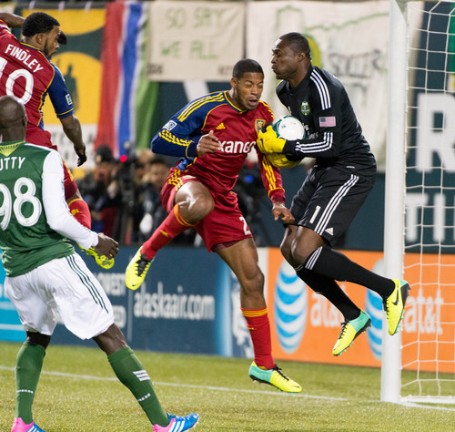 Trent Nelson     The Salt Lake Tribune Real Salt Lake's Chris Schuler (28) collides with Portland's Donovan Ricketts (1), resulting in a scuffle, as Real Salt Lake faces the Portland Timbers, MLS soccer Sunday November 24, 2013 in Portland.