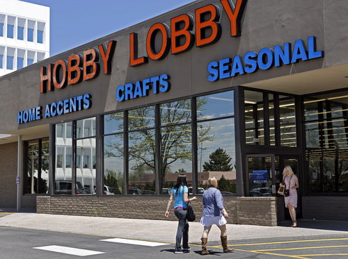 """FILE - This May 22, 2013 file photo shows customer at a Hobby Lobby store in Denver.  President Barack Obama's health care law is headed for a new Supreme Court showdown over companies' religious objections to the law's birth-control mandate.  The administration wants the court to hear its appeal of the Denver-based federal appeals court ruling in favor of Hobby Lobby, an Oklahoma City-based arts and crafts chain that calls itself a """"biblically founded business"""" and is closed on Sundays. Founded in 1972, the company now operates more than 500 stores in 41 states and employs more than 13,000 full-time employees who are eligible for health insurance. The Green family, Hobby Lobby's owners, also owns the Mardel Christian bookstore chain.  (AP Photo/Ed Andrieski, File)"""