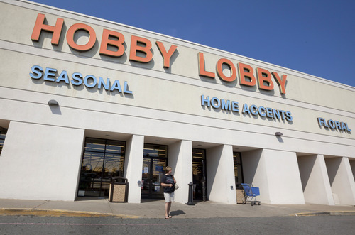 FILE - In this Sept. 12, 2012 file photo, a woman walks from a Hobby Lobby Inc., store in Little Rock, Ark.  (AP Photo/Danny Johnston, File)
