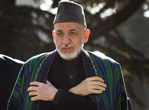 Afghan President Hamid Karzai arrives to  review the guard of honor, during the first day of Eid Al Adha celebrations at the palace in Kabul, Afghanistan, Friday, Oct 26, 2012. Karzai called on Taliban to embrace peace and to join the government and lay down their arms. (AP Photo/Anja Niedringhaus)