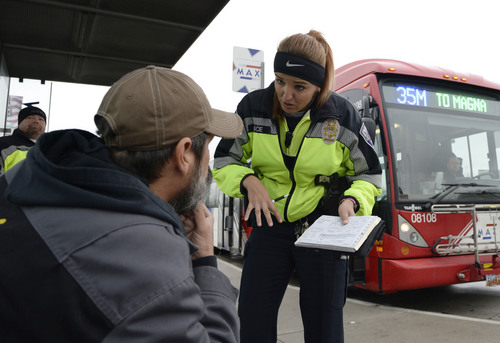 Al Hartmann  |  The Salt Lake Tribune UTA police officer Aymee Race explains the ticket she has just written up to a rider getting off a MAX bus who failed to buy a ticket.