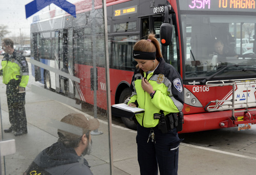 Al Hartmann  |  The Salt Lake Tribune UTA police officer Aymee Race tickets a rider getting off a MAX bus who failed to buy a ticket.